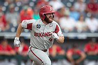 Arkansas Razorbacks first baseman Trevor Ezell (4) runs to first base during Game 5 of the NCAA College World Series against the Texas Tech Red Raiders on June 17, 2019 at TD Ameritrade Park in Omaha, Nebraska. Texas Tech defeated Arkansas 5-4. (Andrew Woolley/Four Seam Images)