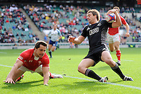 Kurt Baker of New Zealand scores a try past Alex Walker of Wales during the iRB Marriott London Sevens at Twickenham on Saturday 11th May 2013 (Photo by Rob Munro)