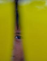 Boys face behind the softdrinks,Buddhist Festival of Light, Mandalay, Myanmar