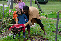 Working in the childrens garden, Yarmouth Community garden camp, Maine USA