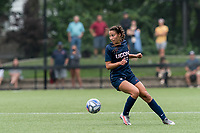 NEWTON, MA - AUGUST 29: Jackie Harnett #41 of University of Connecticut looks to pass during a game between University of Connecticut and Boston College at Newton Campus Soccer Field on August 29, 2021 in Newton, Massachusetts.