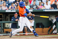 Florida Gators outfielder Buddy Reed (23) swings the bat against the Virginia Cavaliers in Game 13 of the NCAA College World Series on June 20, 2015 at TD Ameritrade Park in Omaha, Nebraska. The Cavaliers beat the Gators 5-4. (Andrew Woolley/Four Seam Images)