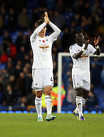Liverpool, UK. Saturday 01 November 2014<br /> Pictured: Swansea player Ki Sung Yueng thanks his away supporters as he walks off the pitch after the end of the game. <br /> Re: Premier League Everton v Swansea City FC at Goodison Park, Liverpool, Merseyside, UK.