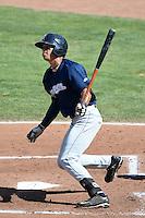 Angel Ortega (10) of the Helena Brewers at bat against the Ogden Raptors at Lindquist Field on July 21, 2013 in Ogden Utah. (Stephen Smith/Four Seam Images)