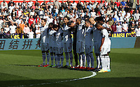 Sunday, 13 April 2014<br /> Pictured: Swansea players observe a minute's silence before kick off.<br /> Re: Barclay's Premier League, Swansea City FC v Chelsea at the Liberty Stadium, south Wales,