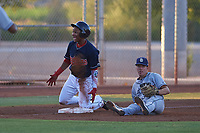 AZL Indians Red Marlin Made (22) reacts to an umpire's call after being tagged out by third baseman Chris Givin (9) during an Arizona League game against the AZL Padres 1 on June 23, 2019 at the Cleveland Indians Training Complex in Goodyear, Arizona. AZL Indians Red defeated the AZL Padres 1 3-2. (Zachary Lucy/Four Seam Images)
