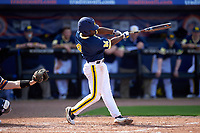 Michigan Wolverines second baseman Ako Thomas (4) at bat during the second game of a doubleheader against the Canisius College Golden Griffins on February 20, 2016 at Tradition Field in St. Lucie, Florida.  Michigan defeated Canisius 3-0.  (Mike Janes/Four Seam Images)