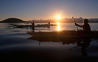 Kayakers race a setting winter's sun as they cross Lynn Canal in Southeast Alaska.