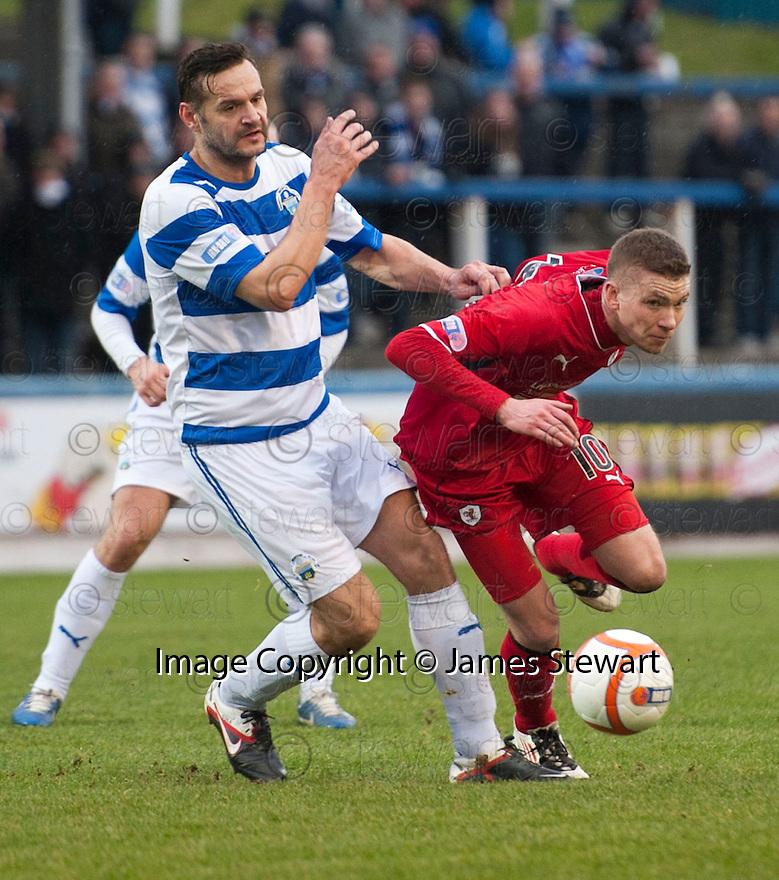 Raith's Pat Clarke tries to get past Morton's Mark McLaughlin.