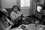 "Jewish family at home north London watching TV in their dinning room cum living room. 1972. The evening meal is over, a bowl of sweets and a tin of Giant Size Cadbury's  Marvel, which was instant milk. They served black coffee and you spooned in your ""instant milk."" The Goodman family at home, Mr David,  Goodman, always known a Lou, was a taxi driver based in Manor House, 1970s UK."
