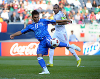 El Salvador's Lester Blanco shoots and scores as Cuba's Reisandry Fernandez looks on.  El Salvador defeated Cuba 6-1 at the 2011 CONCACAF Gold Cup at Soldier Field in Chicago, IL on June 12, 2011.
