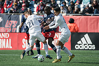 FOXBOROUGH, MA - MARCH 7: Fabian Herbers #21 of Chicago Fire and Mauricio Pineda #22 of Chicago Fire clash with Wilfried Zahibo #23 of New England Revolution in a tackle during a game between Chicago Fire and New England Revolution at Gillette Stadium on March 7, 2020 in Foxborough, Massachusetts.