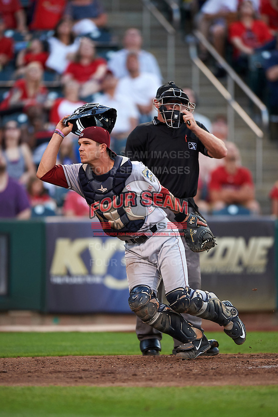 Frisco RoughRiders catcher Patrick Cantwell (3) looks for the ball in front of umpire Jake Wilburn during a game against the Springfield Cardinals  on June 4, 2015 at Hammons Field in Springfield, Missouri.  Frisco defeated Springfield 8-7.  (Mike Janes/Four Seam Images)