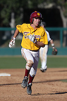 Garrett Stubbs #51 of the USC Trojans runs the bases during a game against the Northwestern Wildcats at Dedeaux Field on  February 16, 2014 in Los Angeles, California. USC defeated Northwestern, 13-6. (Larry Goren/Four Seam Images)