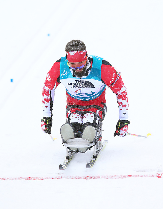 Collin Cameron, PyeongChang 2018 - Para Nordic Skiing // Ski paranordique.<br /> Collin Cameron wins bronze in men's sitting biathlon // Collin Cameron remporte le bronze au biathlon assis masculin. 17/03/2018.