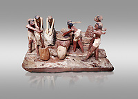 Ancient Egyptian wooden model of bread making, Middle Kingdom, (1939-1875 BC),  Egyptian Museum, Turin.  Grey background. <br /> <br /> Wooden tomb models were an Egyptian funerary custom throughout the Middle Kingdom in which wooden figurines and sets were constructed to be placed in the tombs of Egyptian royalty. These wooden models represented the work of servants, farmers, other skilled craftsman, armies, and religious rituals