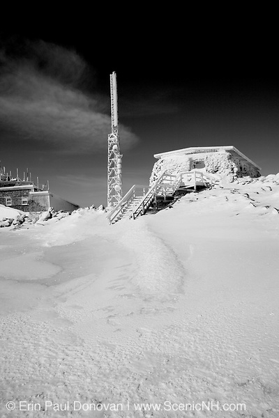 Appalachian Trail - Black & white of The Tip Top House on the summit of Mount Washington during the winter months in the White Mountains, New Hampshire USA