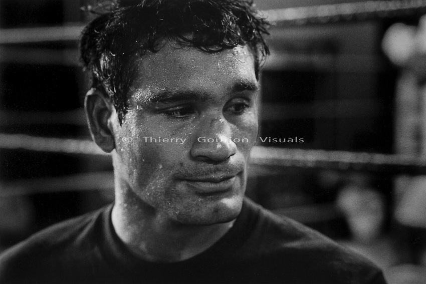 A professional fighter between rounds at Gleason's Gym, Brooklyn, New York.<br />Photograph by Thierry Gourjon-Bieltvedt. 1995-2005