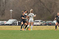 LOUISVILLE, KY - MARCH 13: Emily Fox #11 of Racing Louisville FC and Juliana Lynch #4 of West Virginia University fight for possession during a game between West Virginia University and Racing Louisville FC at Thurman Hutchins Park on March 13, 2021 in Louisville, Kentucky.