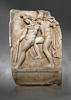 Roman Sebasteion relief sculpture of Achilles and a dying Amazon, Aphrodisias Museum, Aphrodisias, Turkey. Against a grey background.  <br /> <br /> Achilles supports the dying Amazon queen Penthesilea whom he has mortally wounded. Her double headed axe slips from her hands. The queen had come to fight against the Greeks in the Trojan war and Achilles fell in love with her.