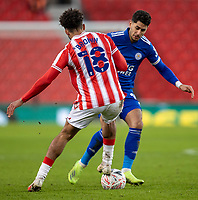 9th January 2021; Bet365 Stadium, Stoke, Staffordshire, England; English FA Cup Football, Carabao Cup, Stoke City versus Leicester City; Jacob Brown of Stoke City tackles Ayoze Perez of Leicester City