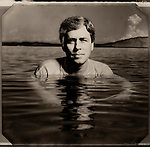 """Author Carl Hiaasen photographed in the water off Islamorada in the Florida Keys for Entertainment Weekly  book """"Stormy Weather"""""""