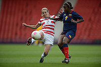 Glasgow, Scotland - Saturday, July 28, 2012:  Heather Mitts of the USA Women's soccer team battles for the ball with Carmen Rodallega (9) during a 3-0 win over Colombia in the first round of the Olympic football tournament at Hamden Park.