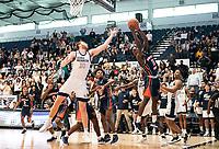 WASHINGTON, DC - NOVEMBER 16: Jamison Battle #10 of George Washington reaches bask as Malik Miller #11 of Morgan State shoots during a game between Morgan State University and George Washington University at The Smith Center on November 16, 2019 in Washington, DC.