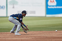 Myrtle Beach Pelicans shortstop Yeison Santana (16) fields a ground ball during the game against the Lynchburg Hillcats at Bank of the James Stadium on May 23, 2021 in Lynchburg, Virginia. (Brian Westerholt/Four Seam Images)