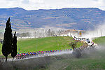 The dust rises during the Strade Bianche 2019 running 184km from Siena to Siena, held over the white gravel roads of Tuscany, Italy. 9th March 2019.<br /> Picture: LaPresse/Fabio Ferrari   Cyclefile<br /> <br /> <br /> All photos usage must carry mandatory copyright credit (© Cyclefile   LaPresse/Fabio Ferrari)