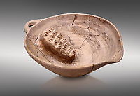 Minoan clay fruit juicer bowl with clay grater, Phaistos Palace 1800-1600 BC; Heraklion Archaeological  Museum, grey background.