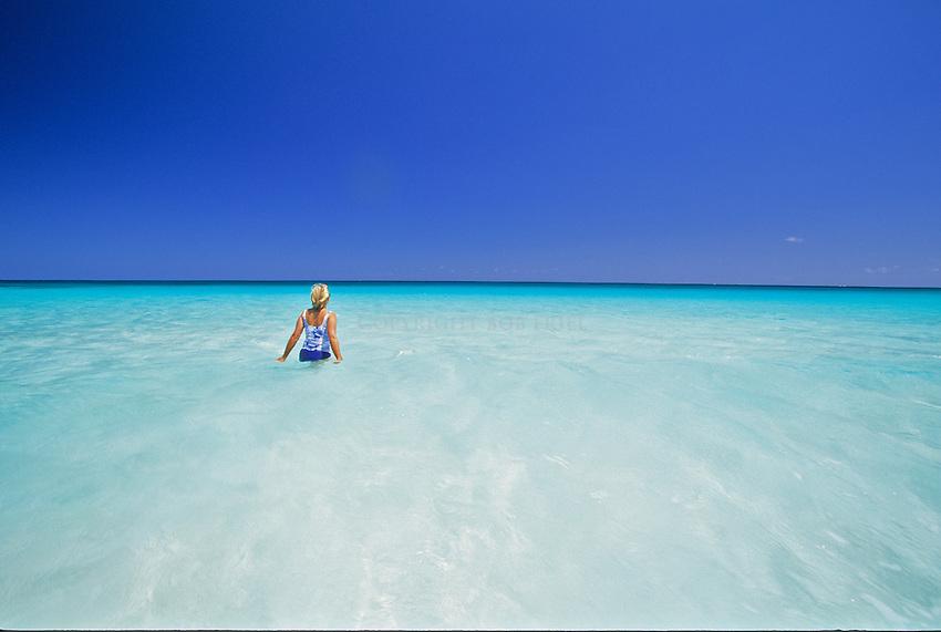 Girl on beach at Great Guana Cay, Abacos, Bahamas