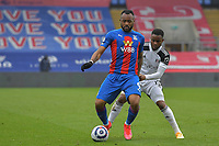 Jordan Ayew of Crystal Palace battles with Ademola Lookman of Fulham during the Premier League behind closed doors match between Crystal Palace and Fulham at Selhurst Park, London, England on 28 February 2021. Photo by Vince Mignott / PRiME Media Images.
