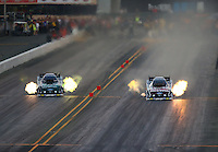 Jul. 25, 2014; Sonoma, CA, USA; NHRA funny car driver Courtney Force (right) races alongside father John Force during qualifying for the Sonoma Nationals at Sonoma Raceway. Mandatory Credit: Mark J. Rebilas-