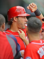 22 July 2012: Washington Nationals outfielder Michael Morse returns to the dugout after scoring against the Atlanta Braves at Nationals Park in Washington, DC. The Nationals defeated the Braves 9-2 to split their 4-game weekend series. Mandatory Credit: Ed Wolfstein Photo