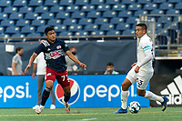 FOXBOROUGH, MA - AUGUST 7: Mateo Rodas #63 of Orlando City B brings the ball forward as Damian Rivera #72 of New England Revolution II  closes during a game between Orlando City B and New England Revolution II at Gillette Stadium on August 7, 2020 in Foxborough, Massachusetts.