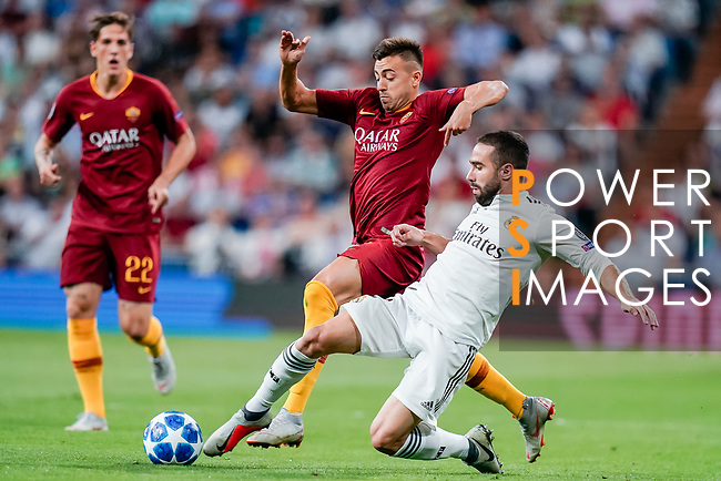Stephan El Shaarawy of Roma (C) fights for the ball with Daniel Carvajal Ramos of Real Madrid (R) during the UEFA Champions League 2018-19 match between Real Madrid and Roma at Estadio Santiago Bernabeu on September 19 2018 in Madrid, Spain. Photo by Diego Souto / Power Sport Images