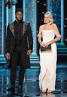 04 March 2018 - Hollywood, California - Chadwick Boseman and Margot Robbie. 90th Annual Academy Awards presented by the Academy of Motion Picture Arts and Sciences held at the Dolby Theatre. Photo Credit: A.M.P.A.S./AdMedia