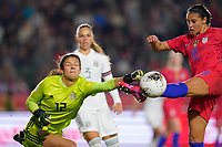CARSON, CA - FEBRUARY 7: Mexico goalkeeper Emily Alvarado #12 and Carli Lloyd #10 of the United States battle for the ball during a game between Mexico and USWNT at Dignity Health Sports Park on February 7, 2020 in Carson, California.