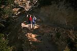 TWO MEN HIKE GRAND CANYON TRAIL