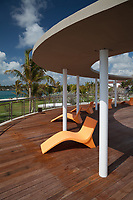 Five Modern Art Deco Orange Sunloungers Under Sunshade on Wood Scenic Ocean View Observation Deck, South Pointe Park, Miami, Florida, FL, America, USA.