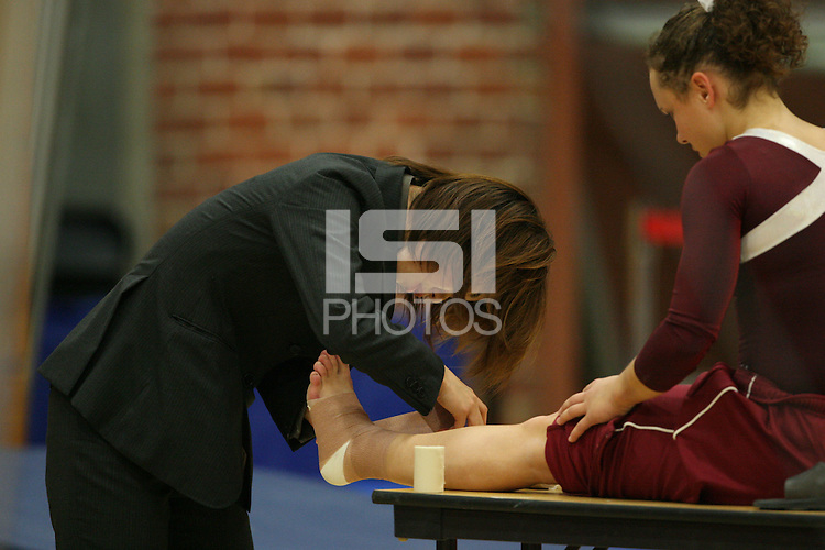 17 February 2006: A trainer during Stanford's win over the University of Arizona at Burnham Pavilion in Stanford, CA.