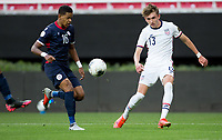ZAPOPAN, MEXICO - MARCH 21: Sam Vines #13 of the United States crosses a ball into the box during a game between Dominican Republic and USMNT U-23 at Estadio Akron on March 21, 2021 in Zapopan, Mexico.