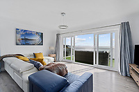 BNPS.co.uk (01202) 558833. <br /> Pic: ScottParry/BNPS<br /> <br /> Pictured: Sitting room. <br /> <br /> Life's a beach...<br /> <br /> A coastal clifftop home above a picturesque Cornish beach is on the market for £1.75m.<br /> <br /> High Seas sits in a prime position above Millendreath Beach in Looe, the 'Cornish Riviera', with spectacular views across Whitsand Bay and out to sea.<br /> <br /> The impressive five-bedroom property has almost 5,000 sq ft of living space and a decent sized garden, but it's real draw is its location.<br /> <br /> The house is 150 yards from Millendreath Beach and its garden gate will take the owners straight onto the South West Coast Path.