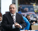 Ally McCoist takes his seat in the dugout