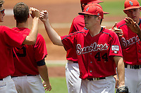 Stony Brook Seawolves pitcher Tyler Johnson #44 is greeted by his teammates following the 8th inning of the NCAA Super Regional baseball game against LSU on June 9, 2012 at Alex Box Stadium in Baton Rouge, Louisiana. Stony Brook defeated LSU 3-1. (Andrew Woolley/Four Seam Images)