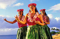 Three hula girls on the beach with pick lei at Ali'i Beach Park, North Shore, Oahu