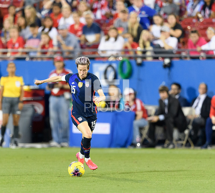 FRISCO, TX - MARCH 11: Megan Rapinoe #15 of the United States brings the ball up the field in the first half against Japan during a game between Japan and USWNT at Toyota Stadium on March 11, 2020 in Frisco, Texas.