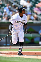 Charlotte Knights right fielder Rymer Liriano (29) swings at a pitch during a game against the  Gwinnett Braves at BB&T Ballpark on May 7, 2017 in Charlotte, North Carolina. The Knights defeated the Braves 7-1. (Tony Farlow/Four Seam Images)