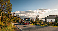 Truck on road at Lake Ianthe at sunset, West Coast, South Westland, South Island, New Zealand